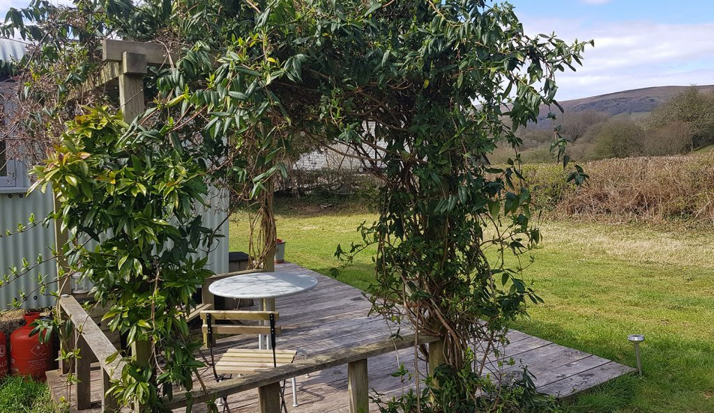 The sheltered pergola with great view across the valley